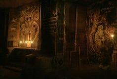 在洞的墙壁绘画与蜡烛 免版税库存照片