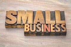 在活版木头类型的小企业横幅 库存图片