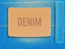 在浅兰的牛仔布织品的皮革标签 传染媒介例证模板 免版税图库摄影