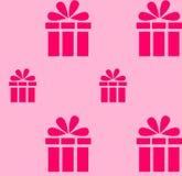 在浅粉红色的背景的桃红色礼物样式 免版税库存图片