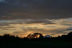 在浩瀚的日落天空 库存照片