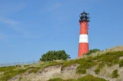 在海岛叙尔特岛上的灯塔在Hoernum 免版税库存图片