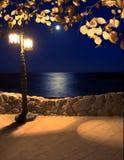 在海岸灯笼的月光 库存图片