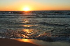在海岸的日落, 图库摄影