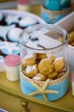 在海星的甜点在海洋主题棒棒糖刺激 免版税库存照片