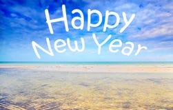 在海景的新年快乐文本 免版税库存图片