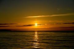 在海洋的美好的日落 库存照片