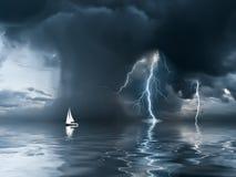 在海洋的雷暴和游艇 免版税库存照片