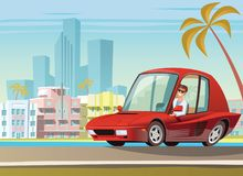 在海洋驱动的红色跑车在迈阿密 免版税库存照片