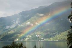 在海湾上的彩虹在挪威 库存照片