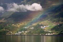 在海湾上的彩虹在挪威 图库摄影