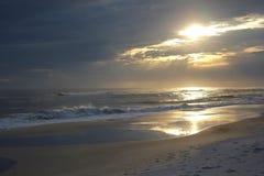 在海湾的日落 免版税图库摄影