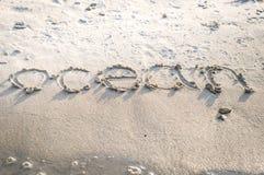 在海滩沙子的题字 免版税库存照片