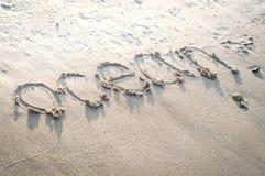 在海滩沙子的题字 免版税图库摄影