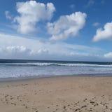 在海滩的一了不起的天 库存照片