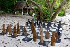 在海滩的古老棋 免版税库存图片