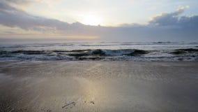 在海滩的日出在外面银行中 免版税库存照片