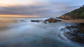 在海滩的日出在德班 免版税图库摄影