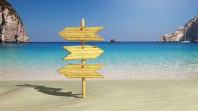 在海滩的木符号 免版税库存照片