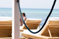 在海滩的椅子 免版税图库摄影