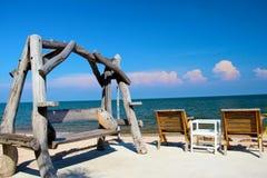 在海滩的椅子 免版税库存照片