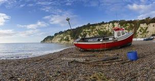 在海滩的渔船在啤酒在德文郡 免版税库存图片