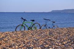 在海滩的自行车 图库摄影