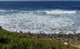 在海滩的风暴日 库存图片