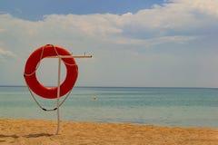 在海滩的Lifebuoy 免版税图库摄影