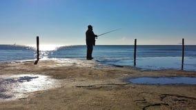 在海的一位渔夫 库存图片