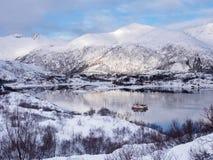 在海的两个渔船在Lofoten海岛,挪威上的Svolvaer附近在冬天 库存图片