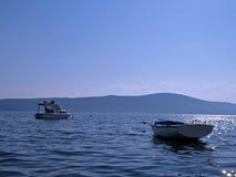 在海的两条小的小船 免版税库存图片