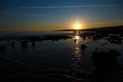 在海的日落有石头的 免版税图库摄影