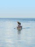 在海的渔夫 免版税库存照片