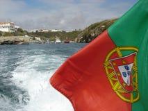 在海的葡萄牙旗子 免版税图库摄影