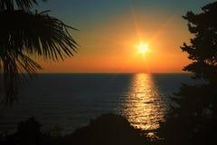 在海的迷人的日落 库存照片