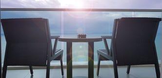 在海视图阳台的两把椅子 免版税库存图片