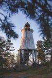在海角Besov没有的灯塔,奥涅加湖岸 图库摄影
