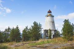 在海角Besov没有的灯塔,奥涅加湖岸 库存图片