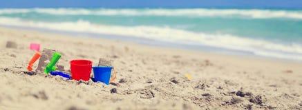 在海滩概念的孩子戏剧 库存照片