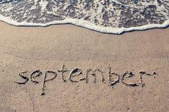 在海滩沙子的9月 库存照片