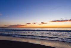 在海洋海滩7的五颜六色的日落 库存照片