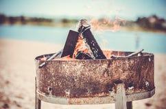 在海滩照片的篝火 库存图片