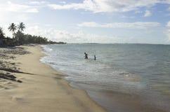 在海滩的一个晴天 图库摄影