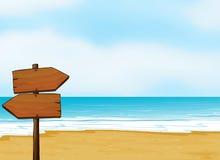 在海滩的一块布告牌 库存照片