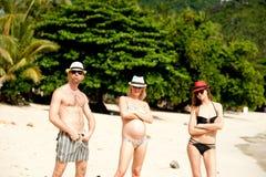 在海滩的三重奏 免版税库存照片