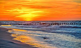 在海滩的假日日落 库存照片