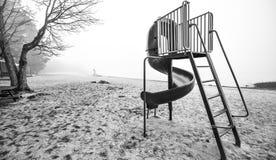 在海滩的儿童的幻灯片 免版税库存图片