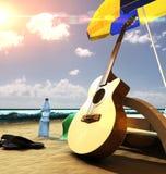 在海滩的吉他 库存图片