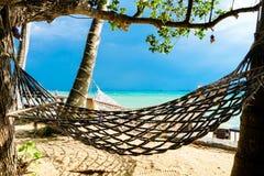 在海滩的吊床在多暴风雨的天气 图库摄影